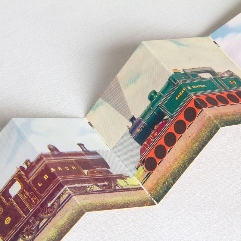 Accordion book with trains and collage pages