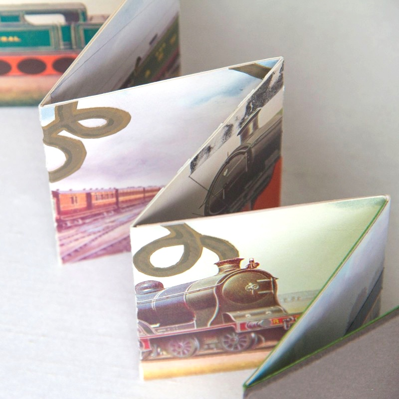 Collages of trains inside handmade artist's book