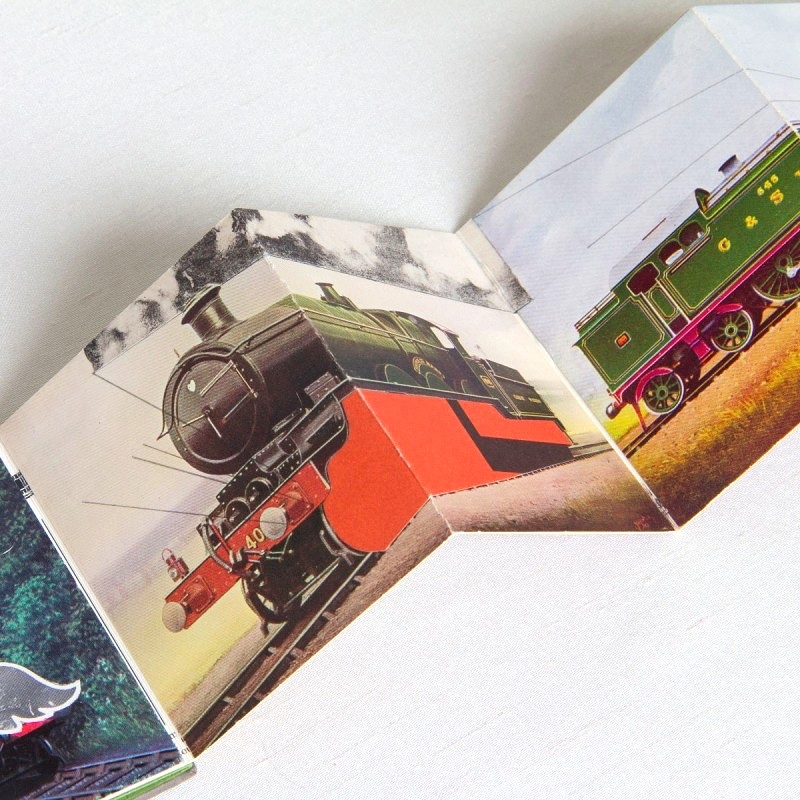 Page with collage of train in artist book