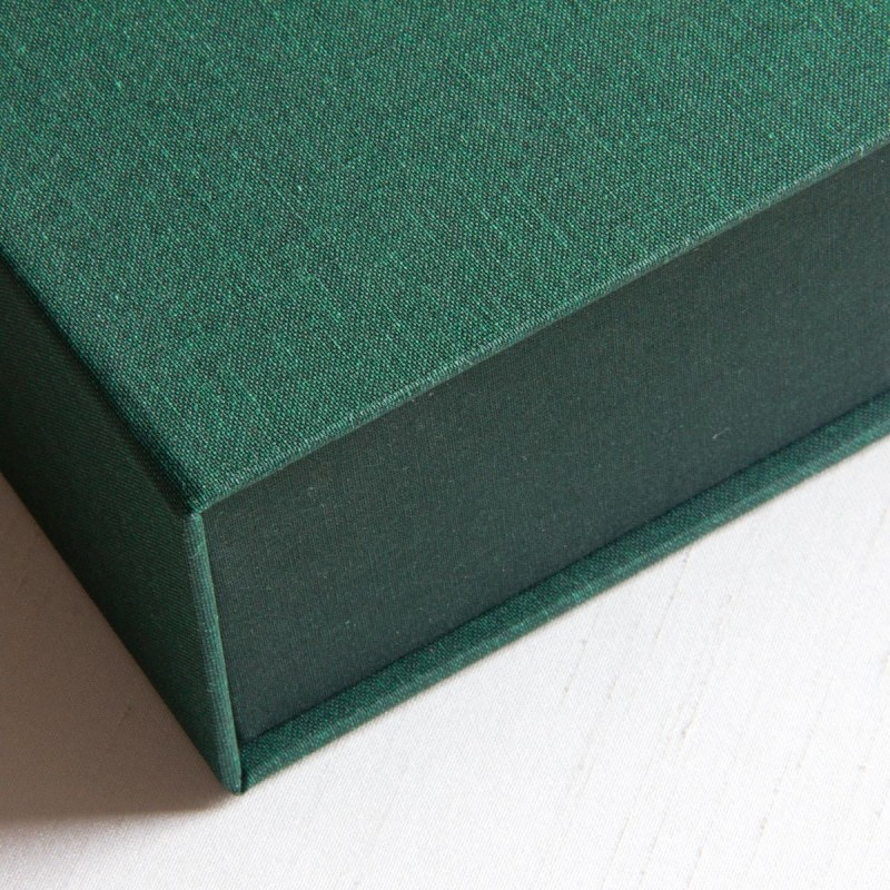 Two tone green book cloth on cover of handmade archival clamshell box