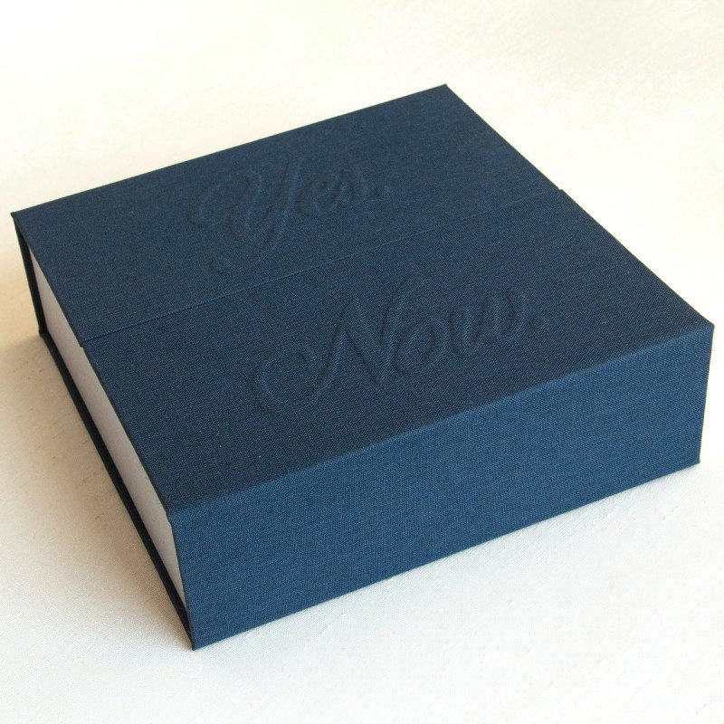 Navy and grey handmade box with Yes. Now. emboss on cover