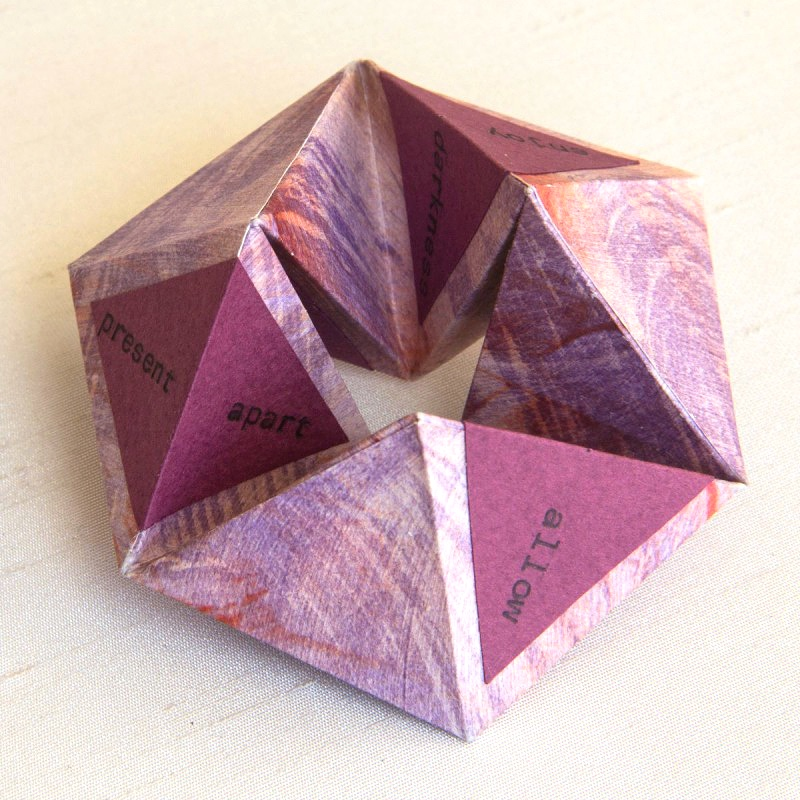 Pink kaleidocycle made with paste paper
