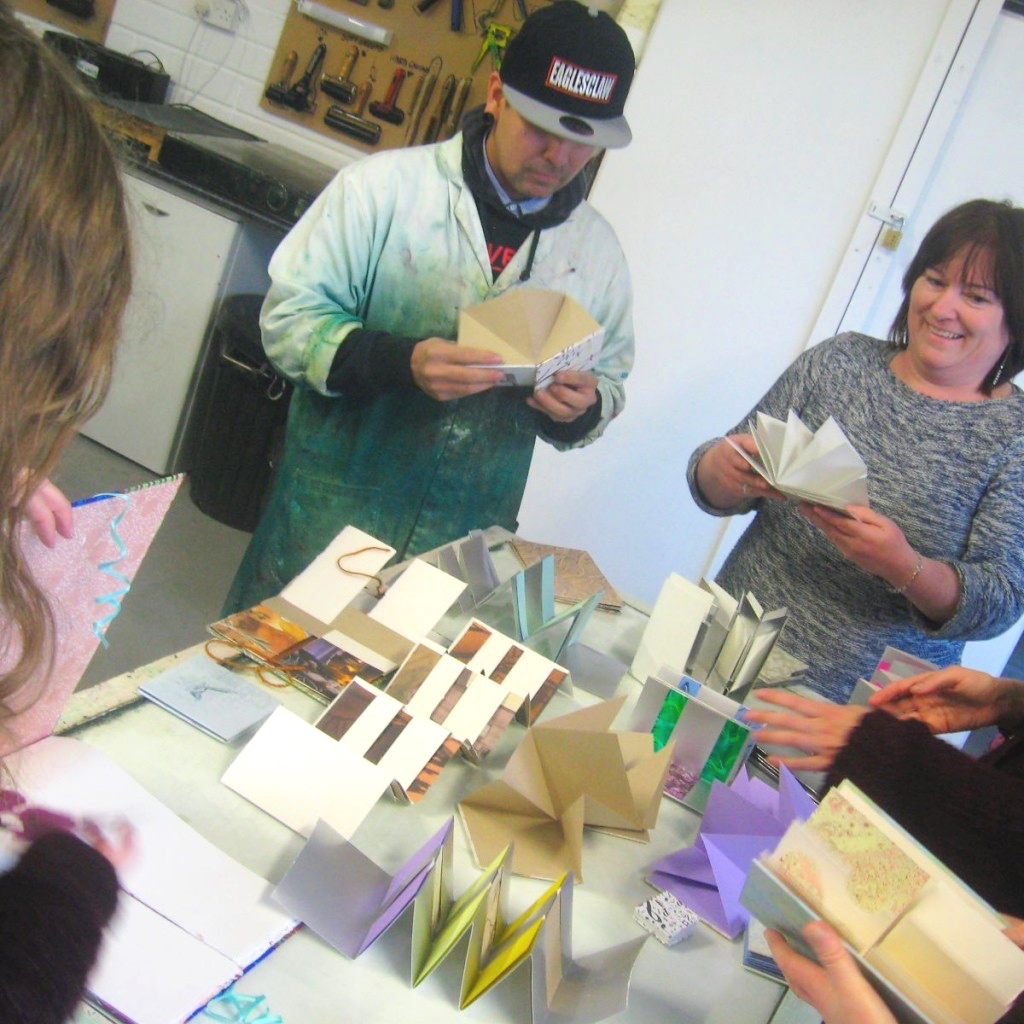 Bookbinding workshop participants looking at handmade books, Galway, Ireland