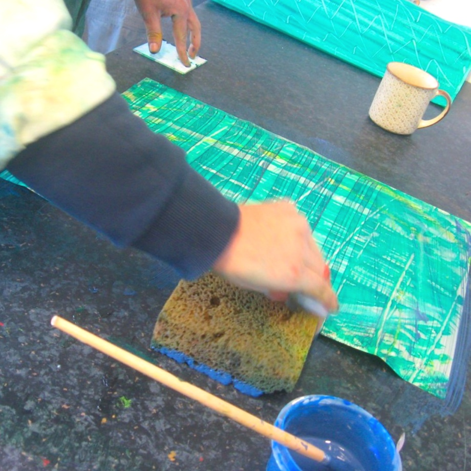 Making paste paper with green paint