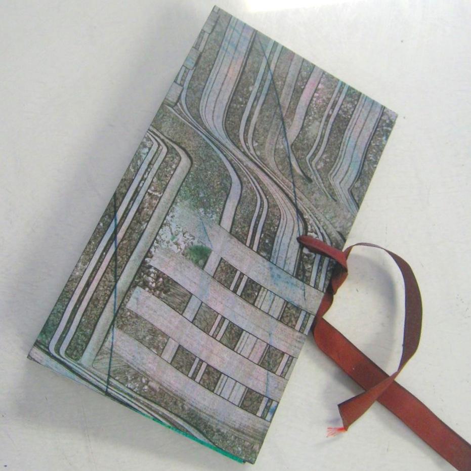 Paste paper cover on handmade artist's book