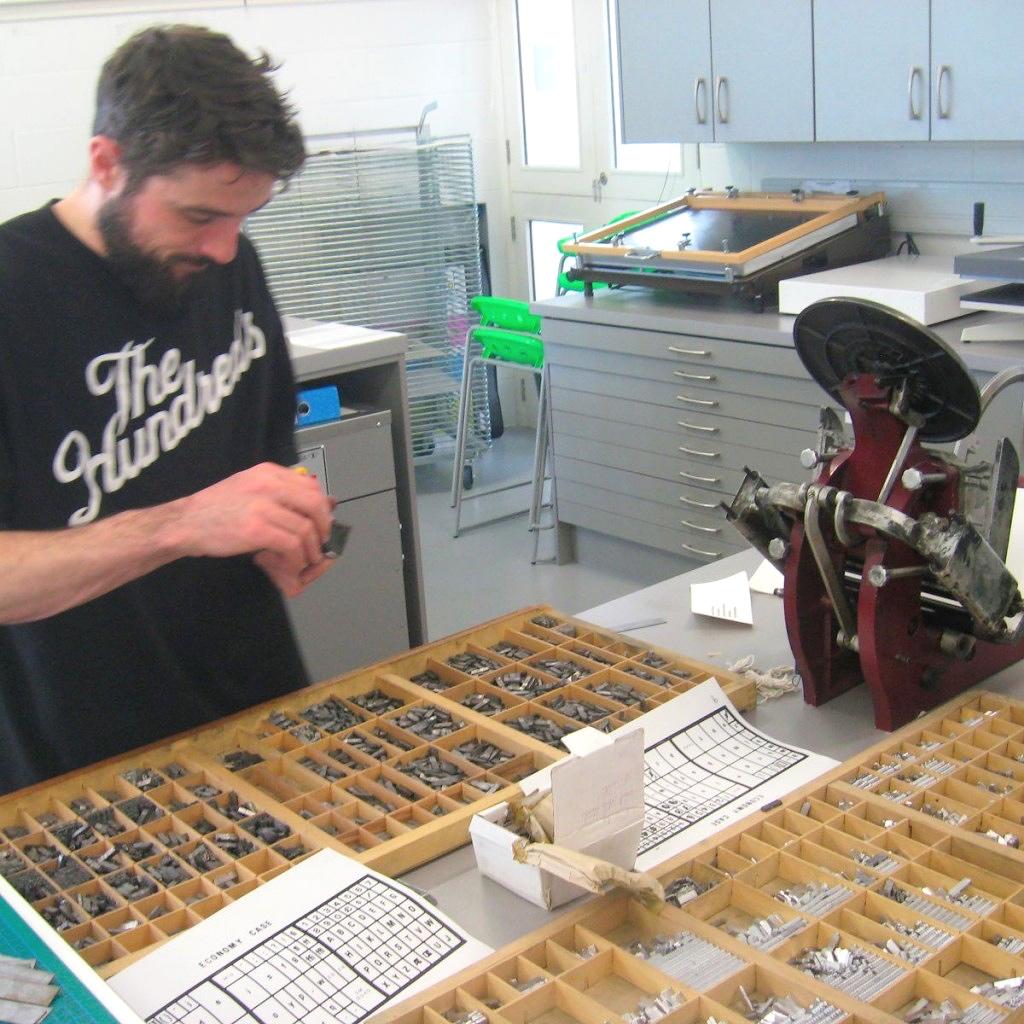 Typesetting trays on table at letterpress bookbinding workshop Ireland
