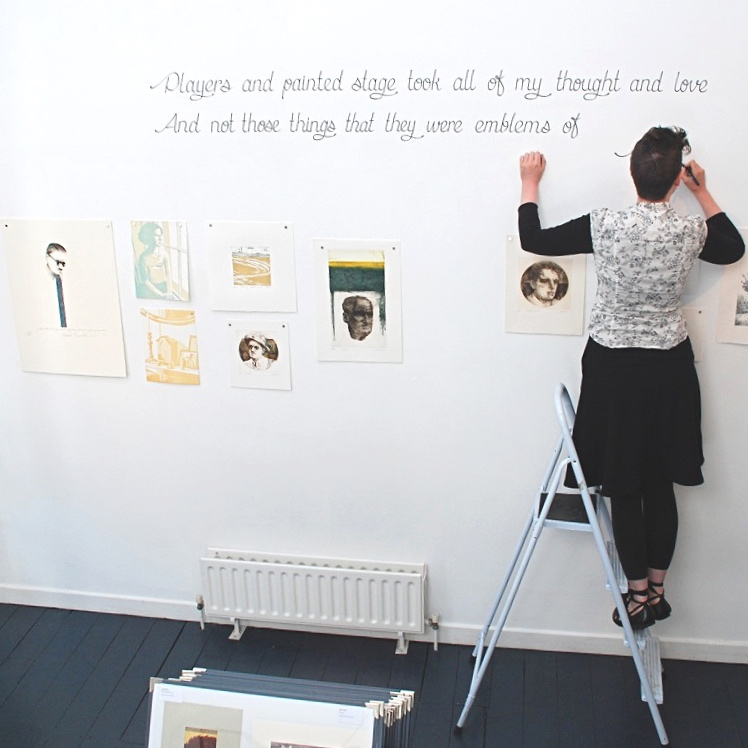 Éilís Murphy writing Yeats quote on gallery wall