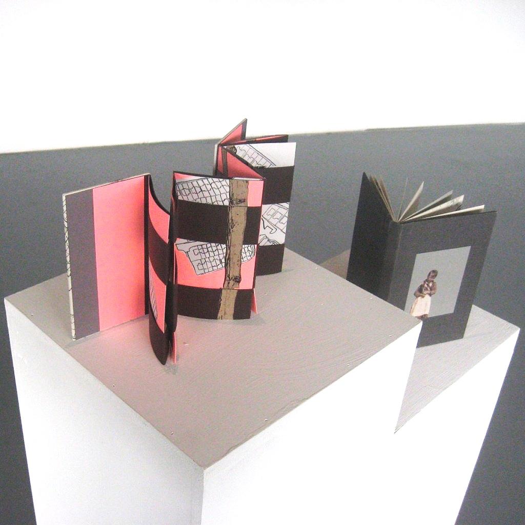 Two handmade artist's books on plinth