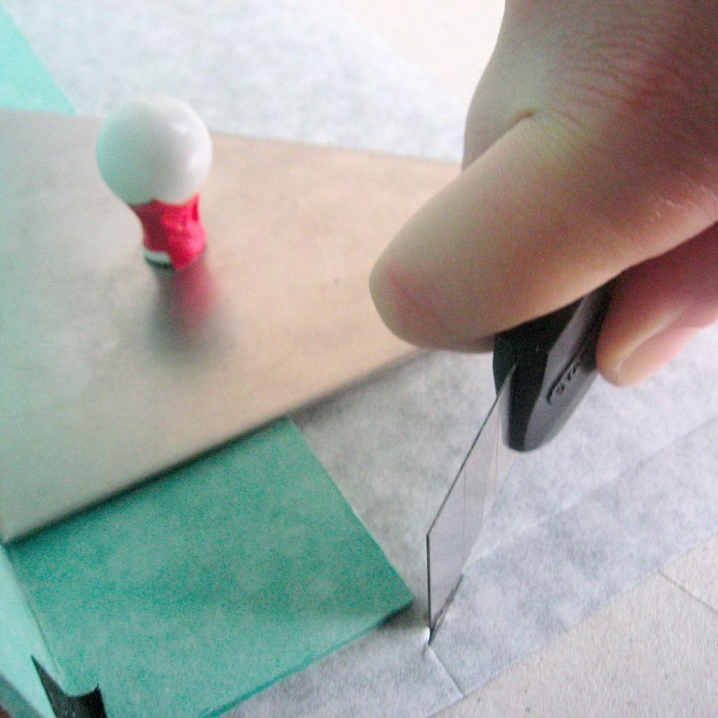 Cutting book cloth with scalpel on handmade box