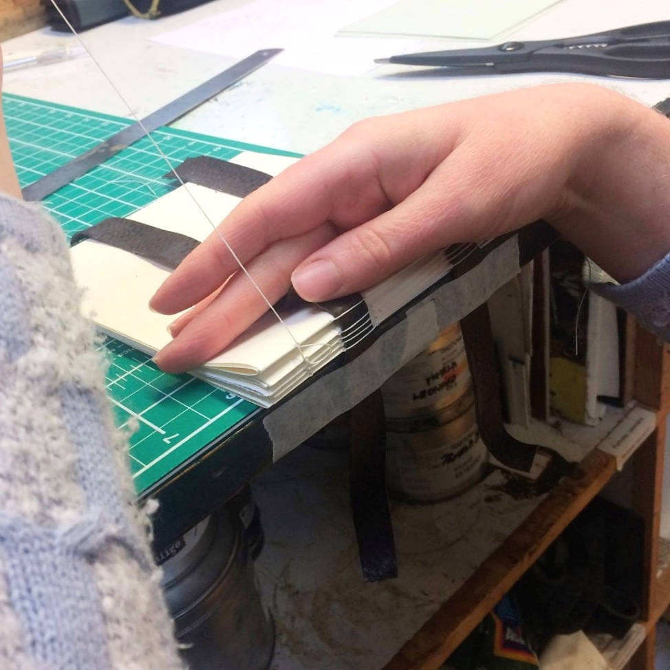 Binding the spine of a book