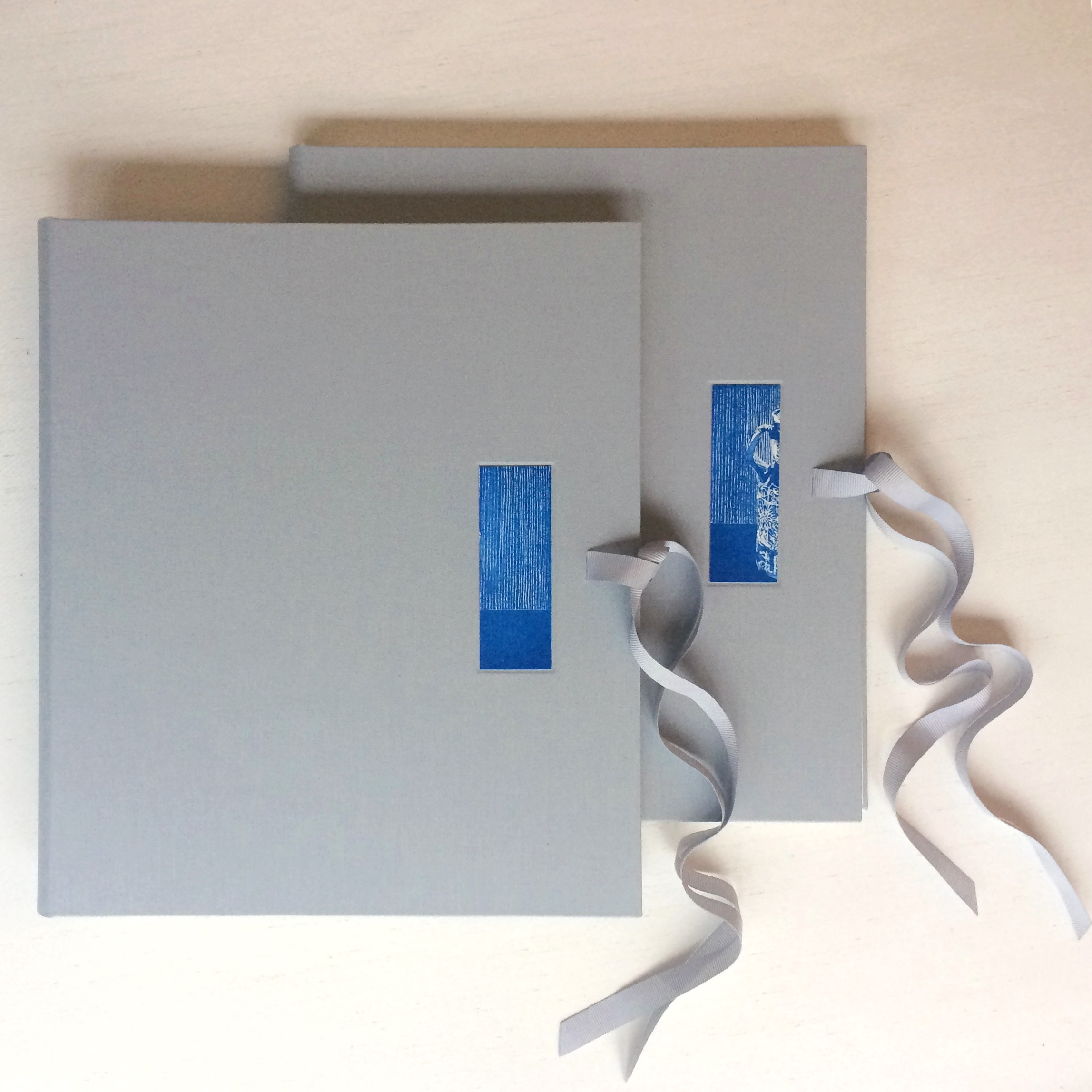Grey cover with blue print recessed into cover of handmade portfolio