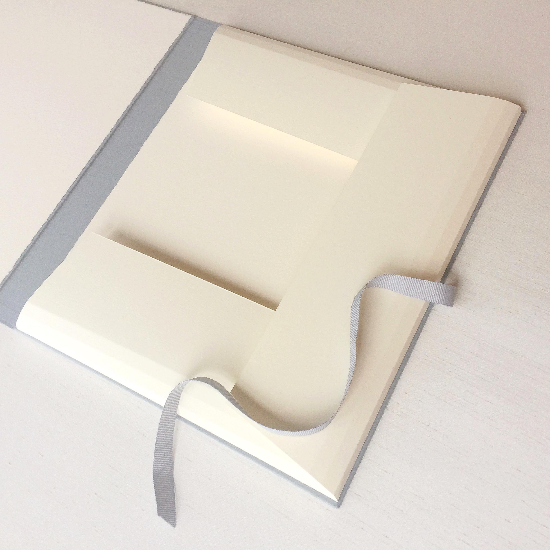 Cream flaps inside archival handmade portfolio for artist