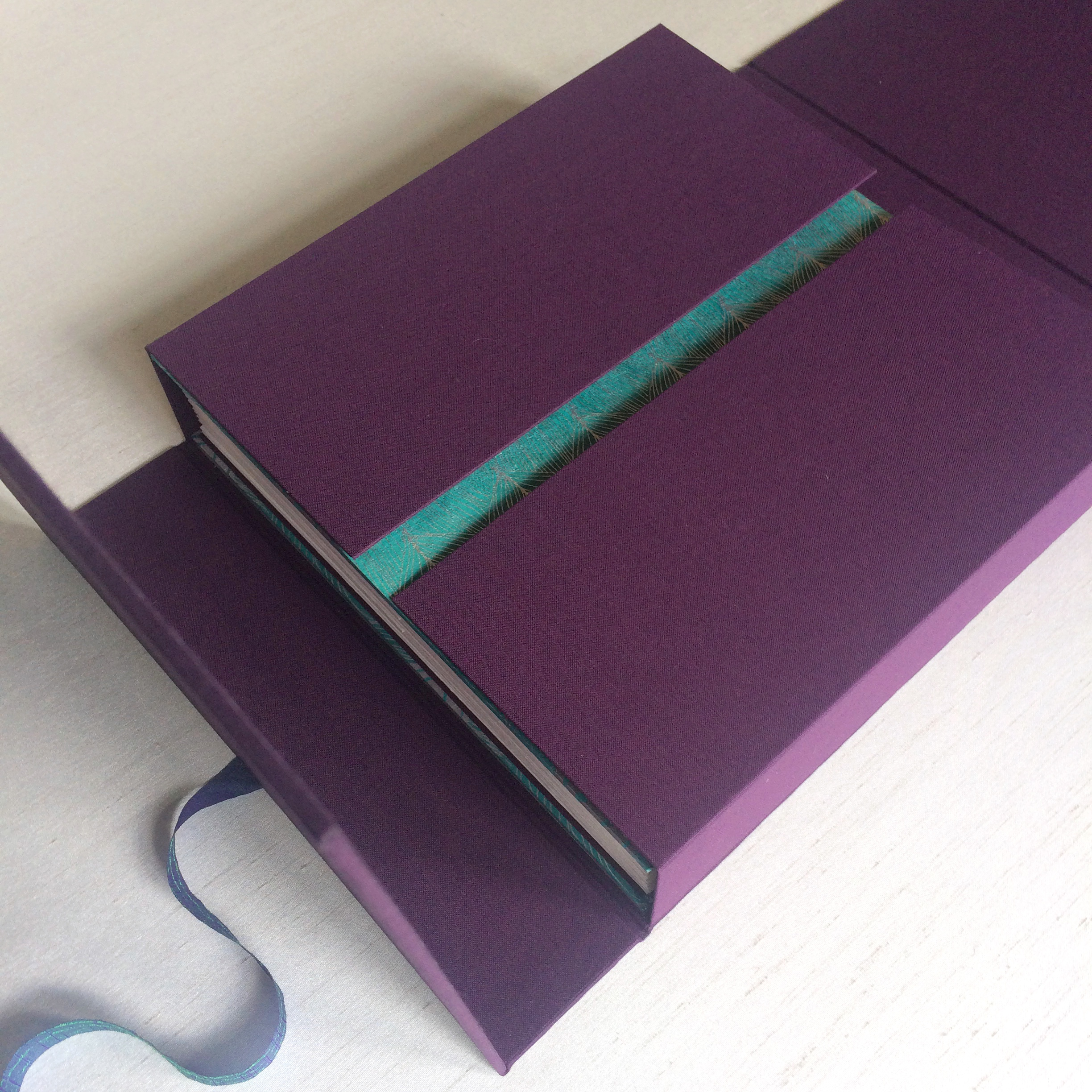 Purple foldout box customised to hold handmade photo album