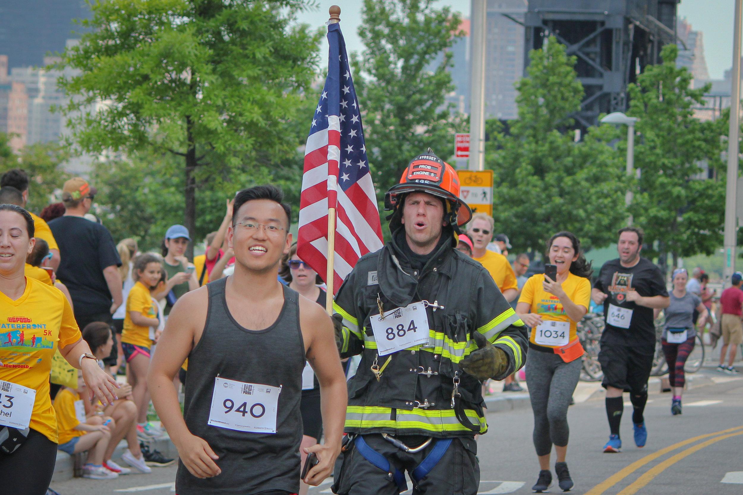 FDNY firefighter running in full uniform.