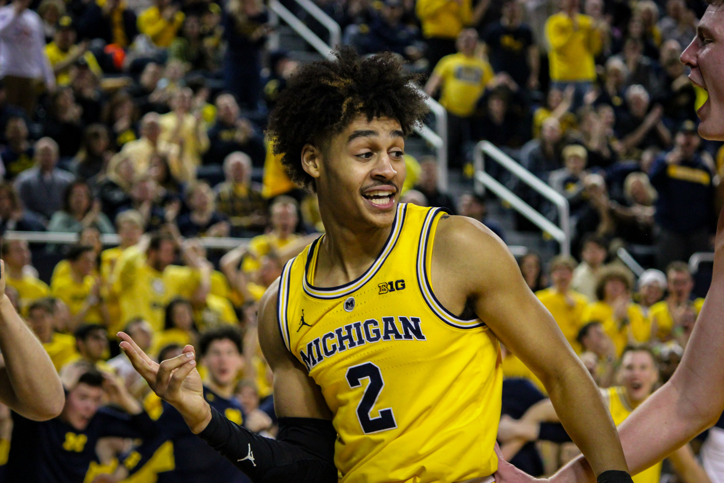 Jordan Poole posing after a score and a foul.