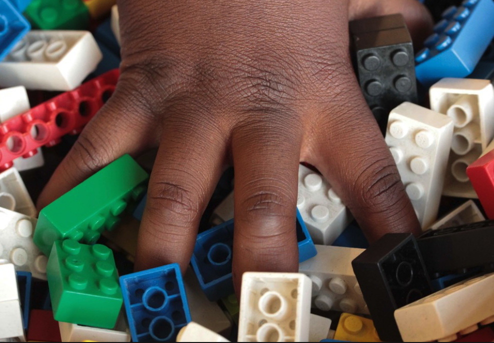 Black-Girl-hand-in-legos.png