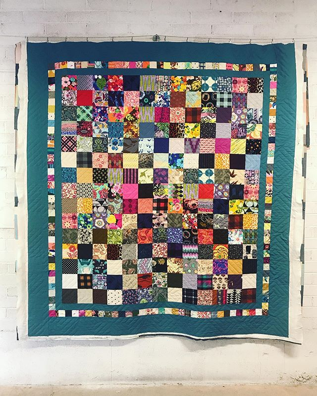 latest quilt off the machine... this was done for a coworker of mine. the medium grey thread blends nicely with all the colors in this quilt. Thank you Leila!
