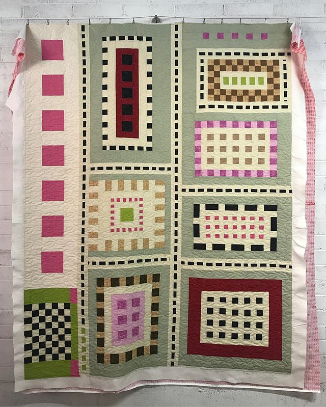 just finished up this quilt for my mom. she started this project years ago (it might have been her first quilt top...) and it's finally quilted and ready for binding!