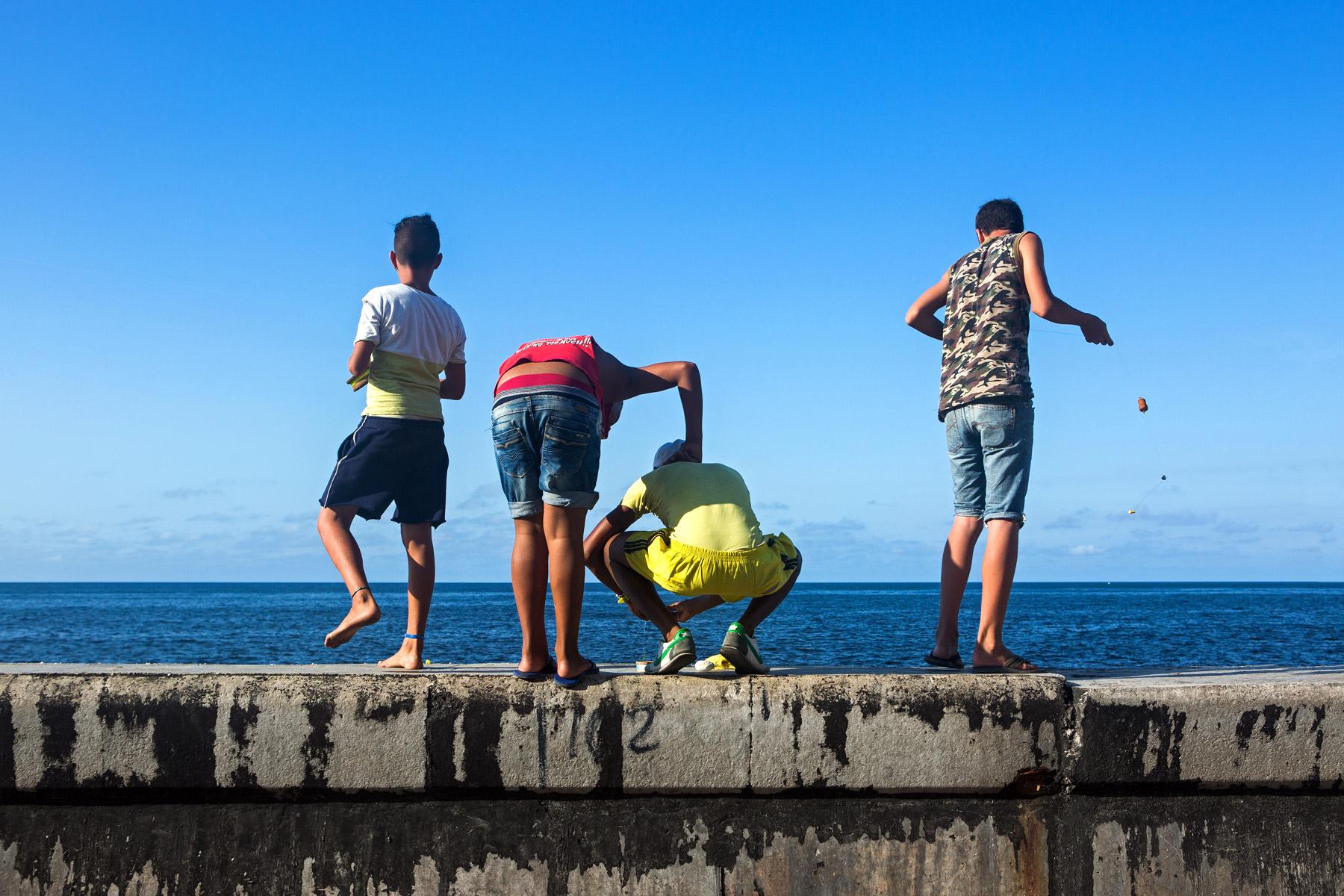 Kids fishing off the Malecon in Havana, Cuba