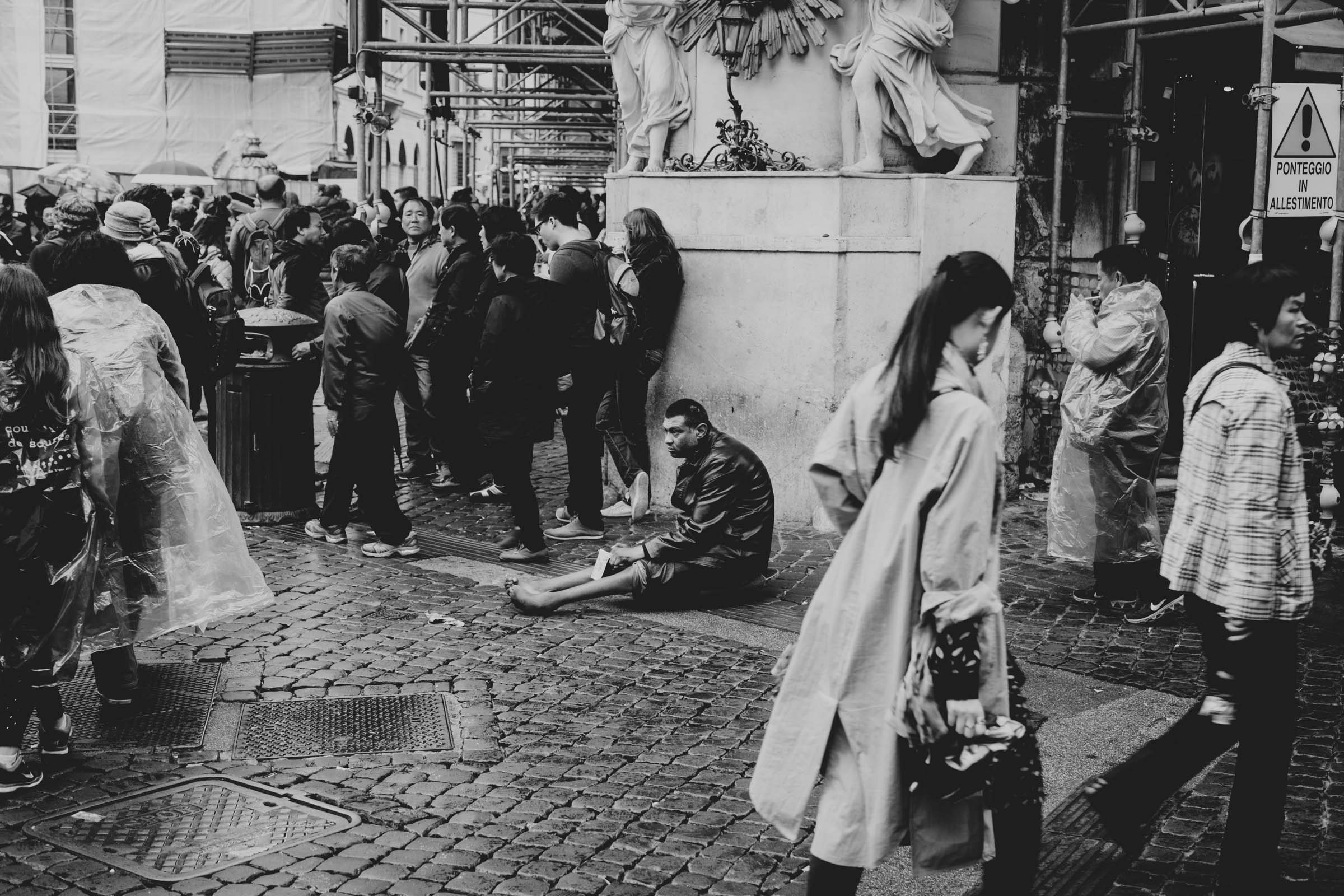 ABOVE:A man begging on the streets near the Trevi Fountain. I'd been warned that many homeless resolve to faking disabilities or injuries in the hopes to evoke sympathy and thus earning some extra money.