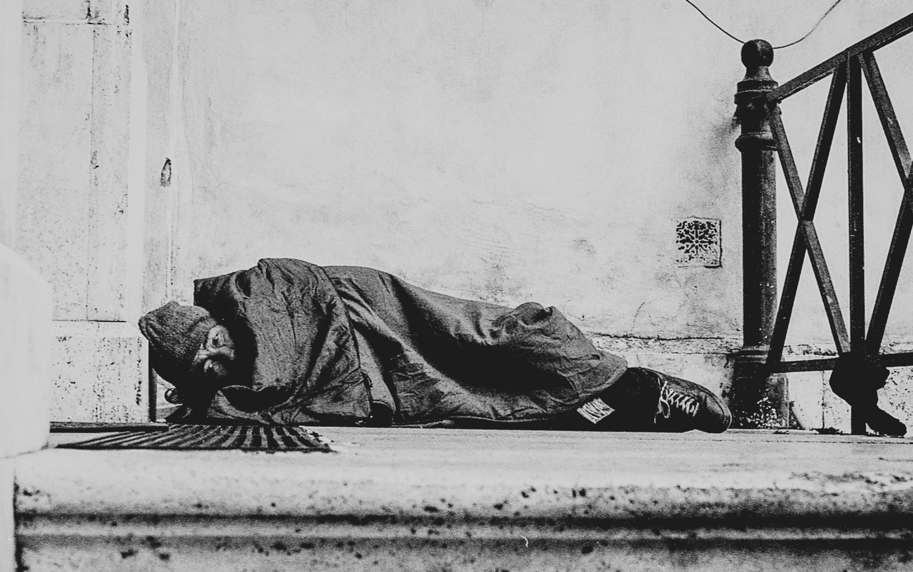 ABOVE and BELOW: My first encounter with a homeless man, sleeping on the stepsof a churcha ten minute walk from the city centre.