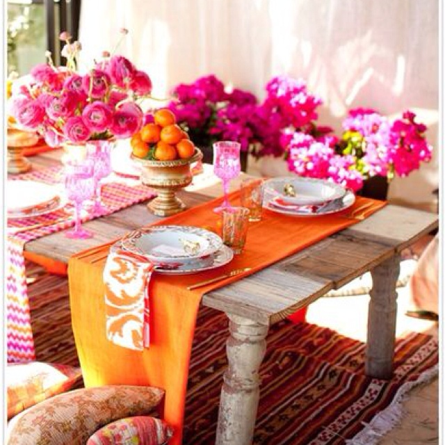 Combine Textures - A rustic table with oversized throw pillows is so inviting. The table itself is nicely layered with individual runners that show off the beautiful wood.