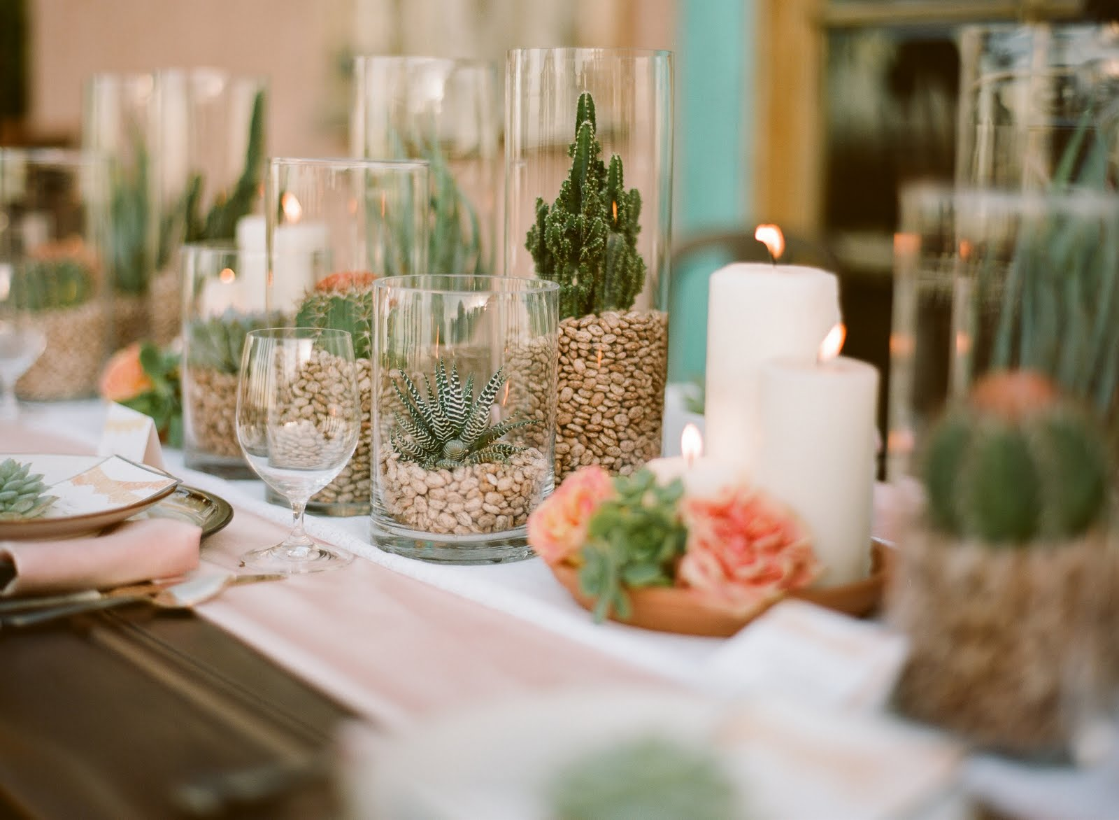 Unique Centerpiece - Instead of flowers use mini glass vases filled with succulents. The earthy look is elegant and a nice change from roses.