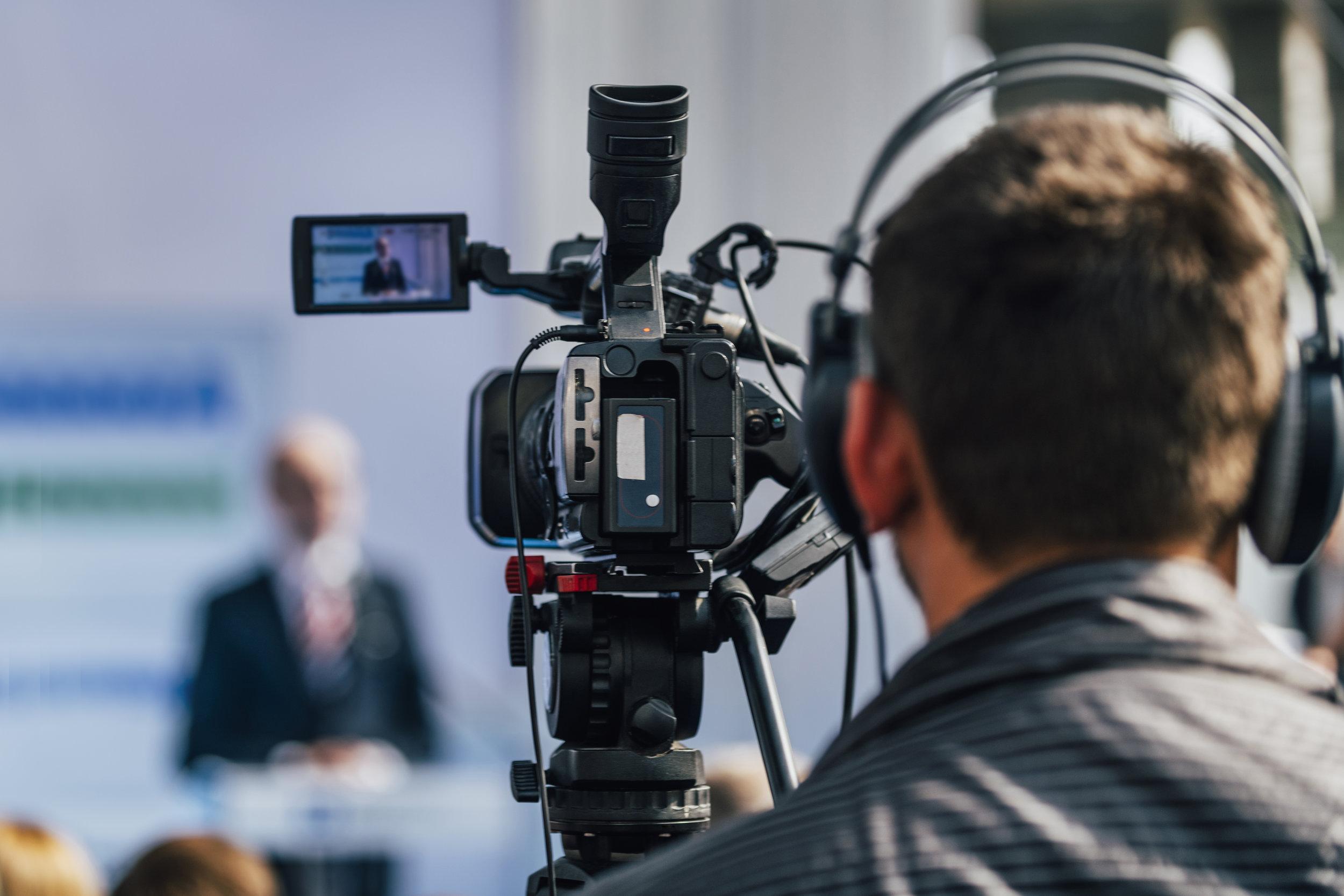 press-conference-event-cameraman-recording-male-KQXCBLM.jpg