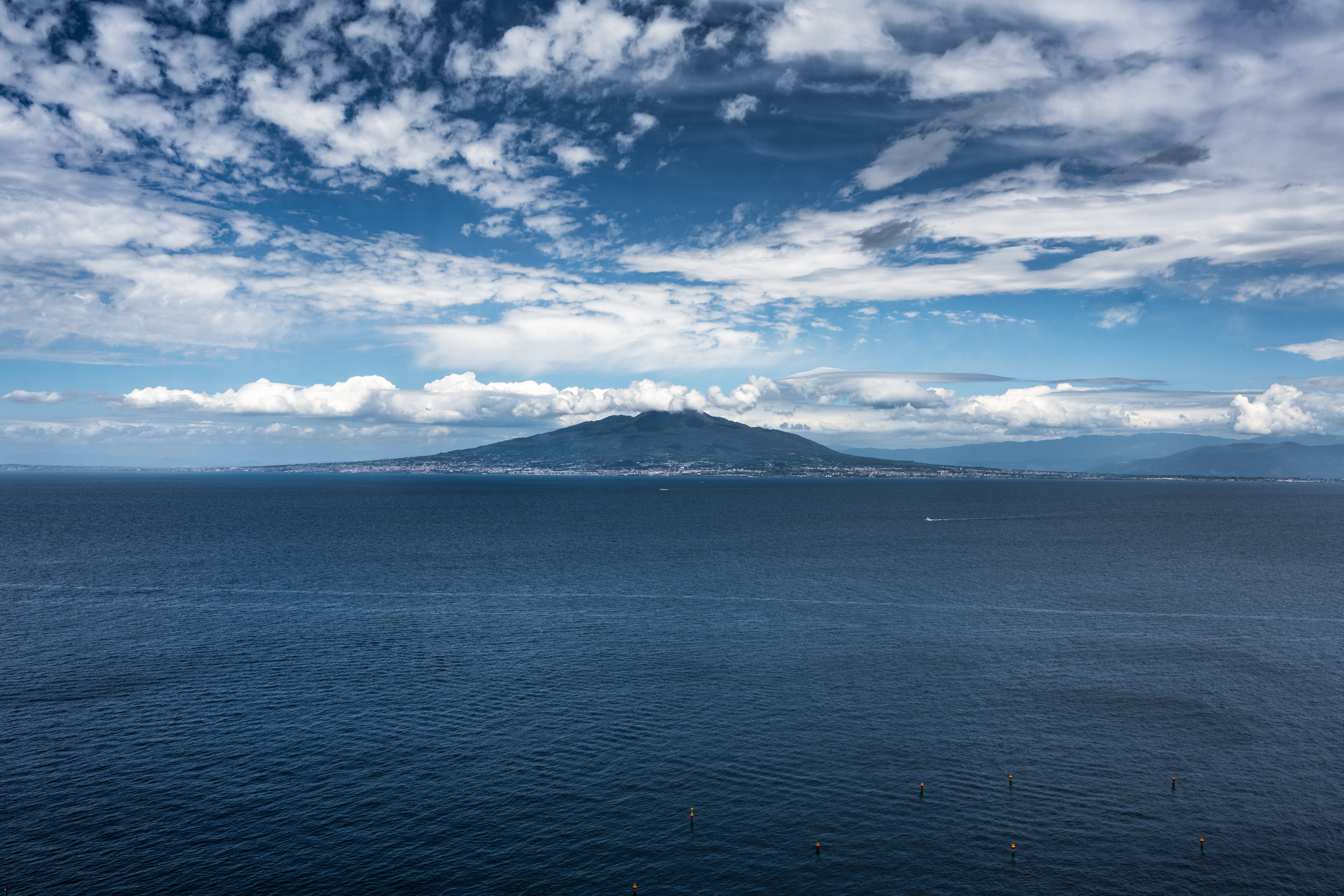 On a clear day you can see Mount Vesuvius towering on the opposite side of the Bay of Naples.