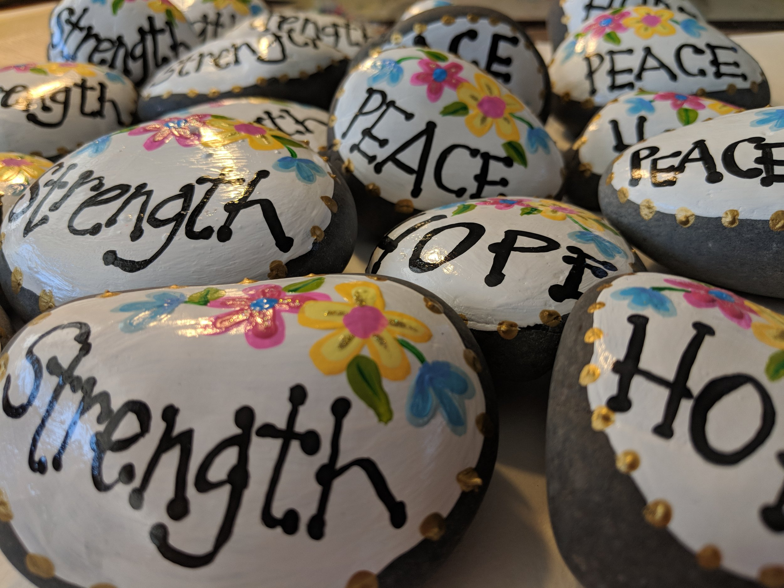 Hand painted rocks that I created and donated to an organization that hosted a retreat for women suffering child loss.