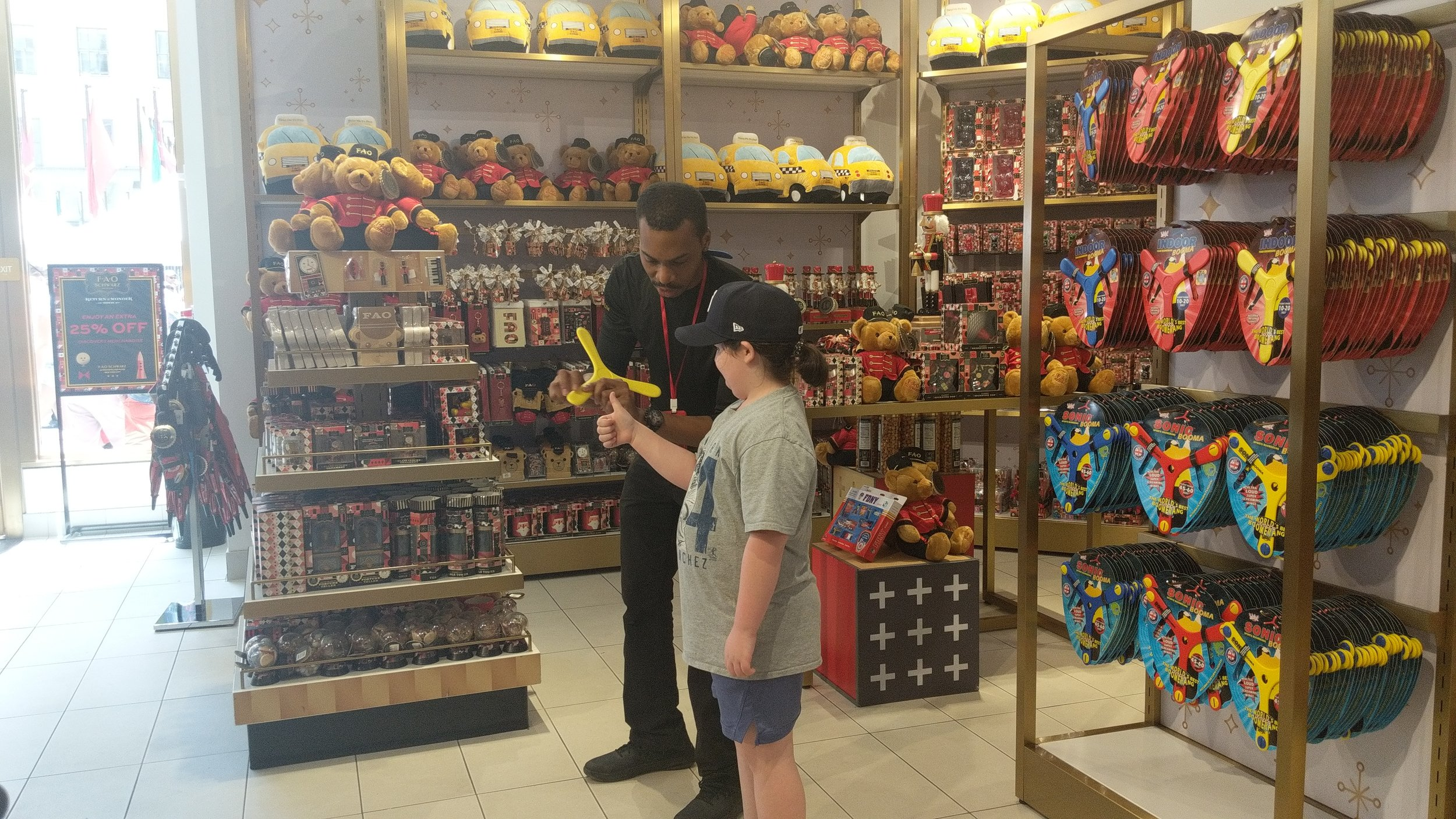 Learning about flying a boomerang from the fantastically fun guy at FAO Schwartz.