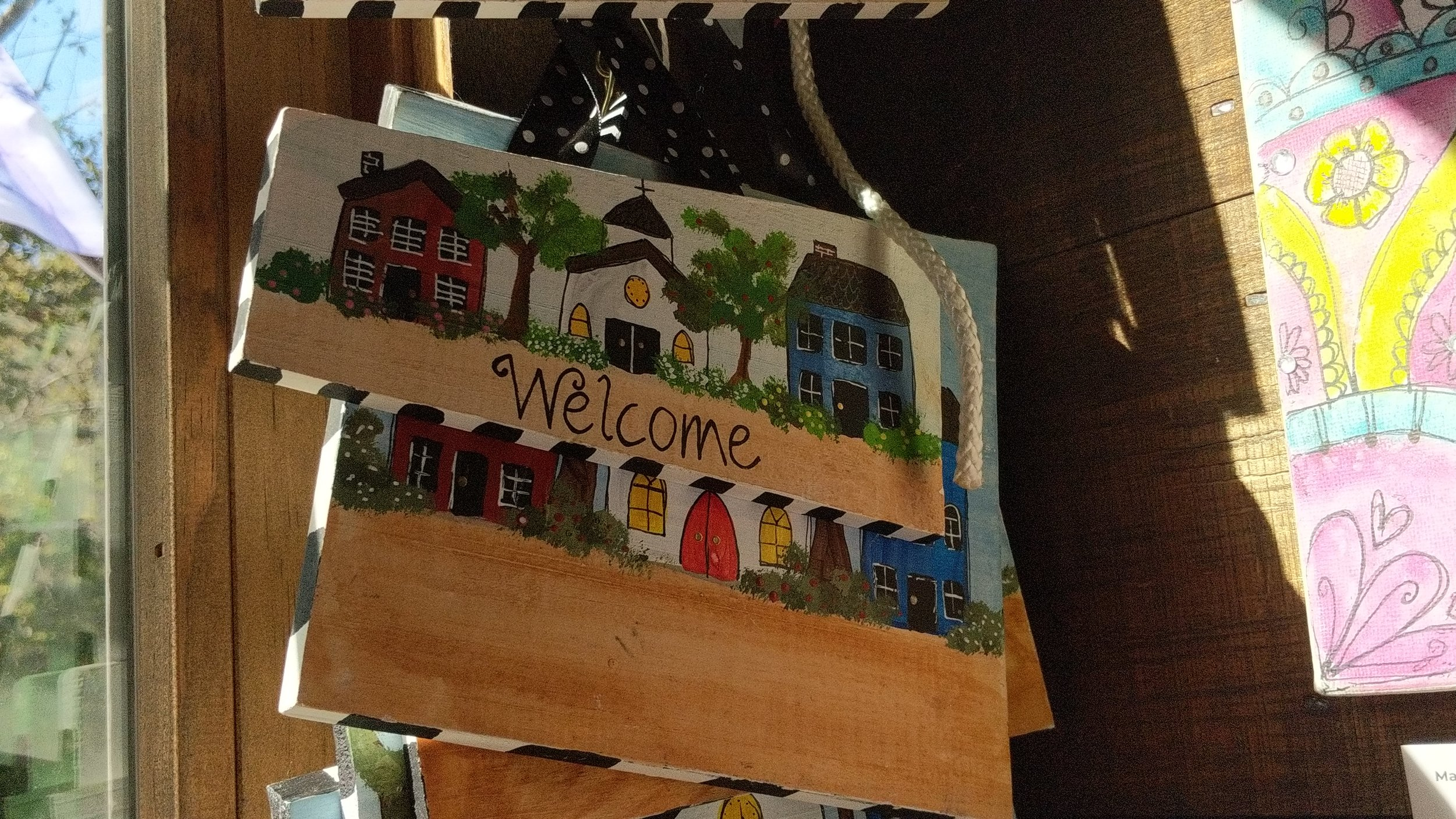 "Hanging by the front door of my shop are my little hand painted ""Welcome"" signs. Some are blank that can be customized, like with your town name or last name. These are hand painted onto the boards that my little kiddos broke when they took Tae Kwon Do so each board size is slightly different but still very cool!"