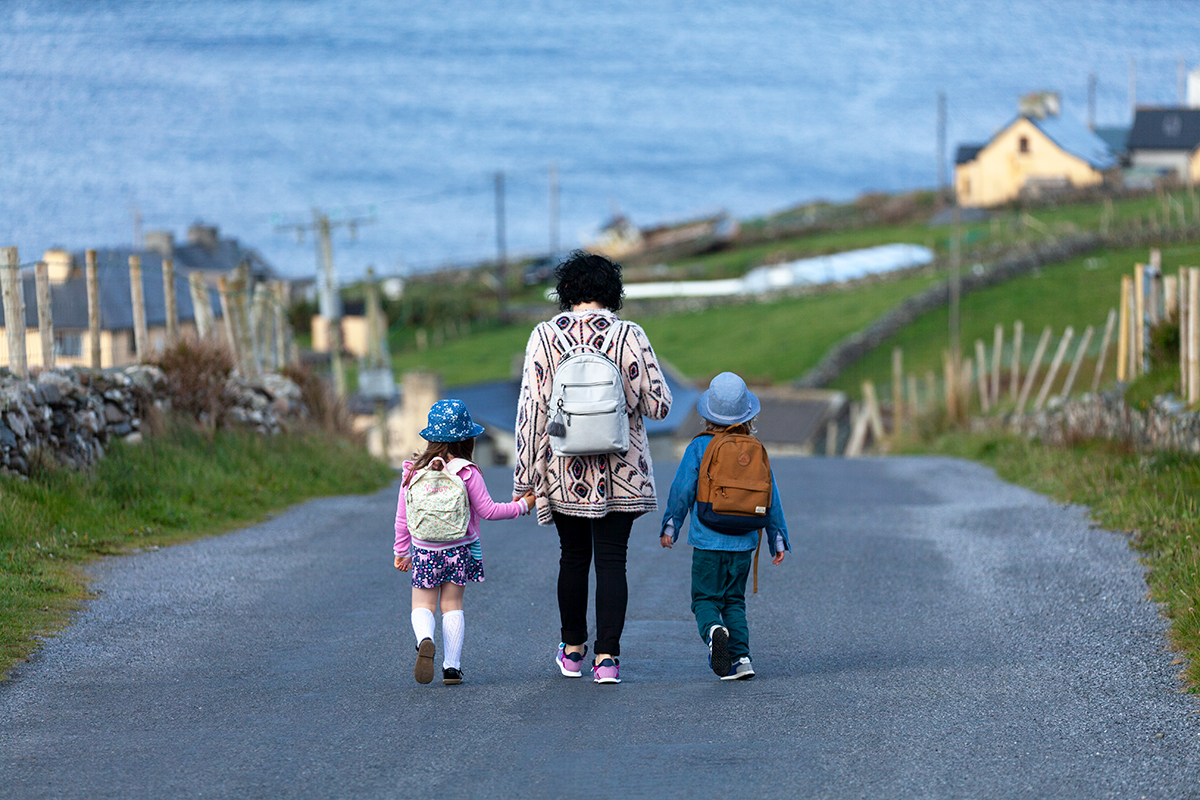 Tara, Kilty and Nancy walking down the hill to school and work.