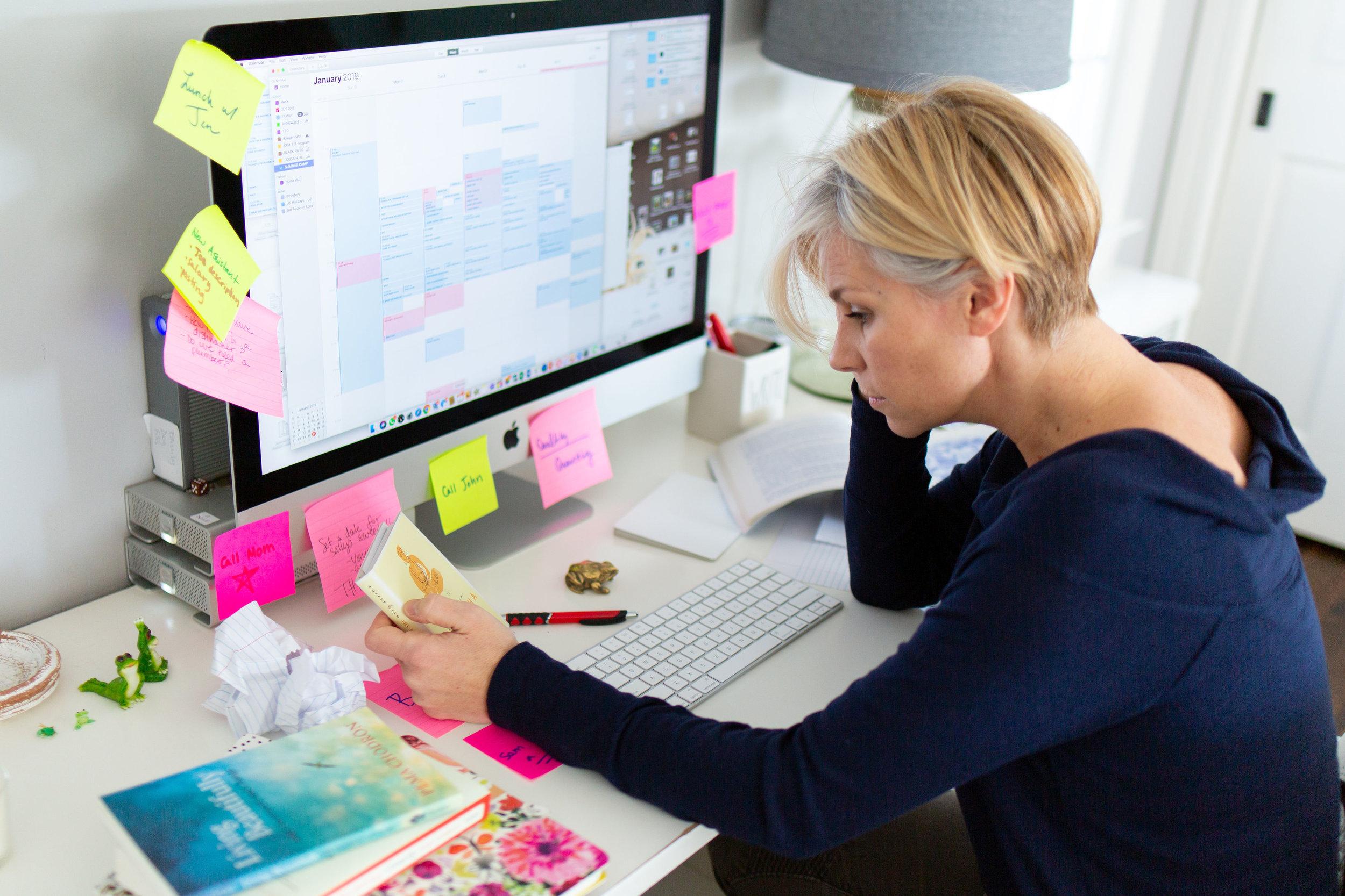 Woman Cluttered Desk.jpg