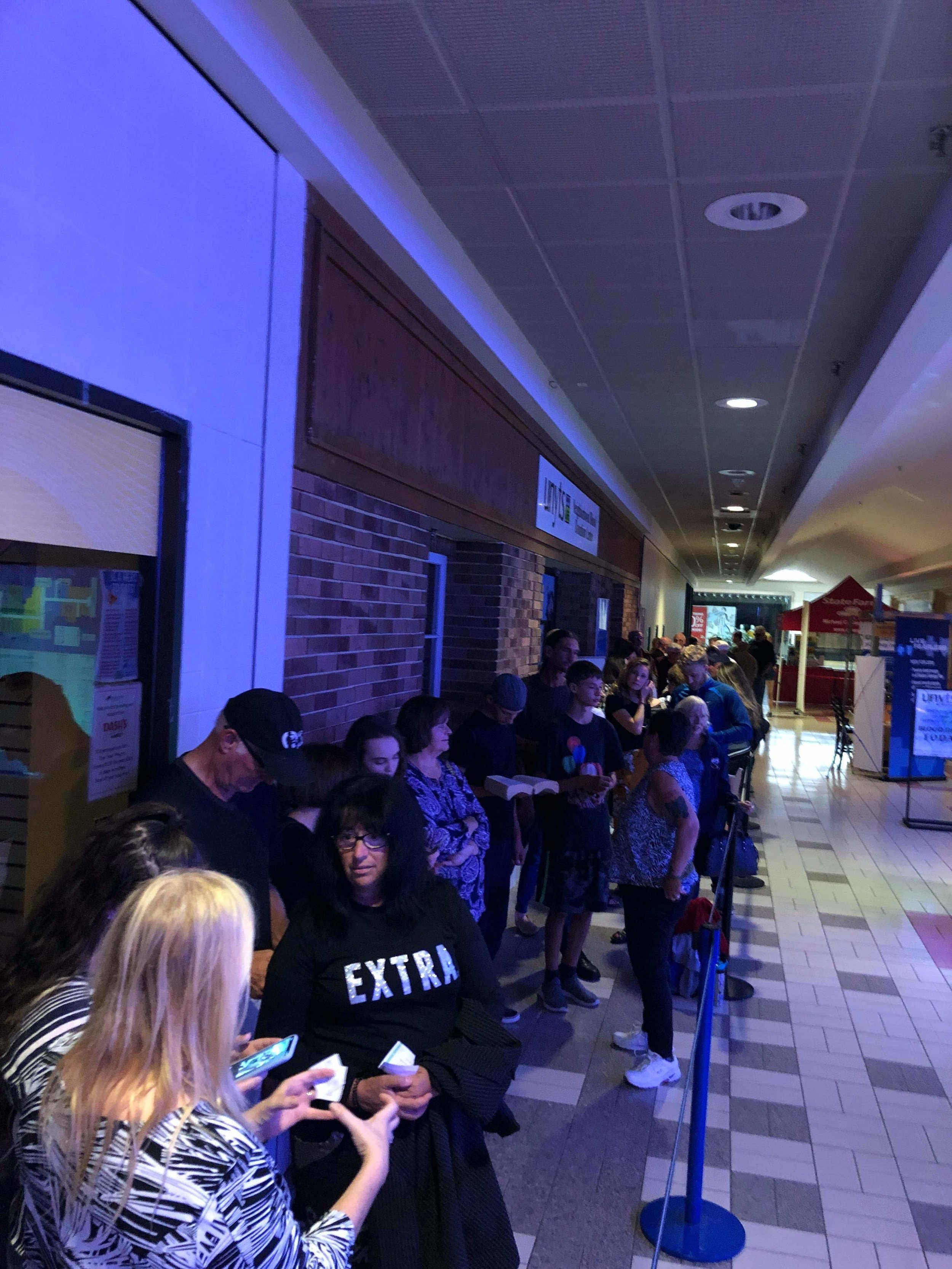 The ticket holders' line outside the theater stretching down into the mall!