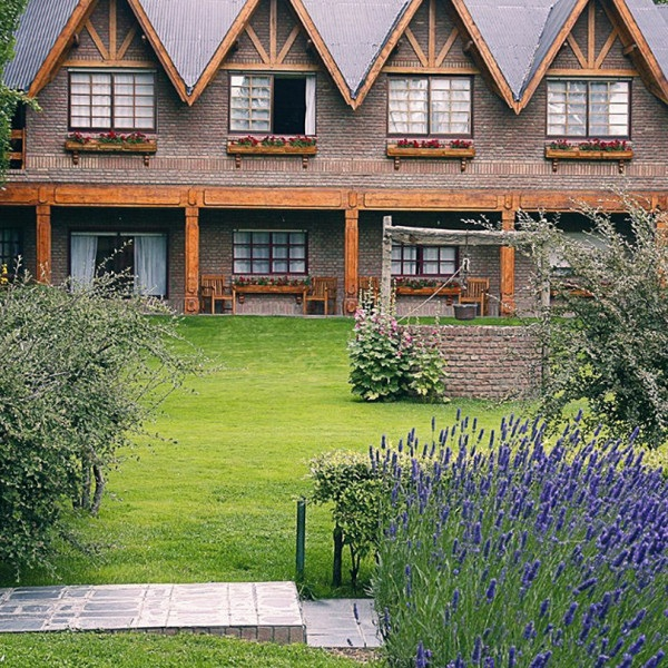 POSADA LOS ALAMOS - Santa Cruz, ArgentinaOverlooking Golf el Pinar golf course, this elegant hotel in a distinctive timber and stone building is a stone's throw from the beautiful glacial Lago Argentino and a short walk into the chic downtown area of El Calafate.