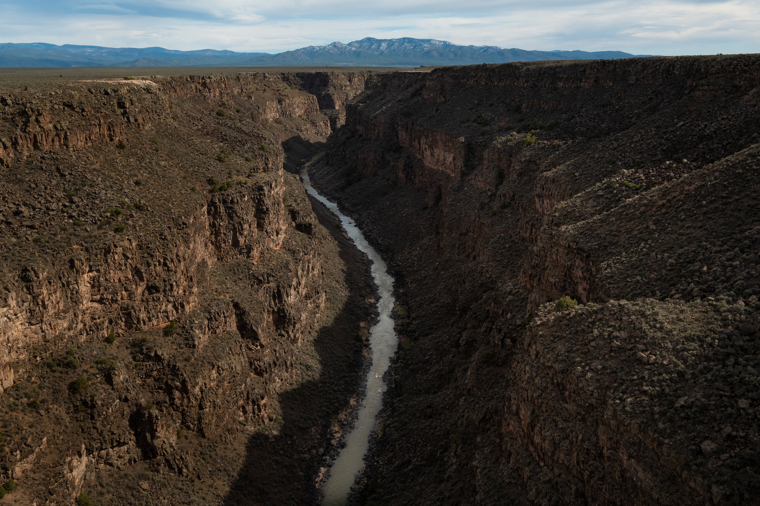 A popular attraction outside Taos, the Rio Grande Gorge Bridge is the second highest bridge on the US Highway System. Originating in Colorado, the Rio Grande flows 1,885 miles cutting the border between Texas and Mexico and emptying into the Gulf .