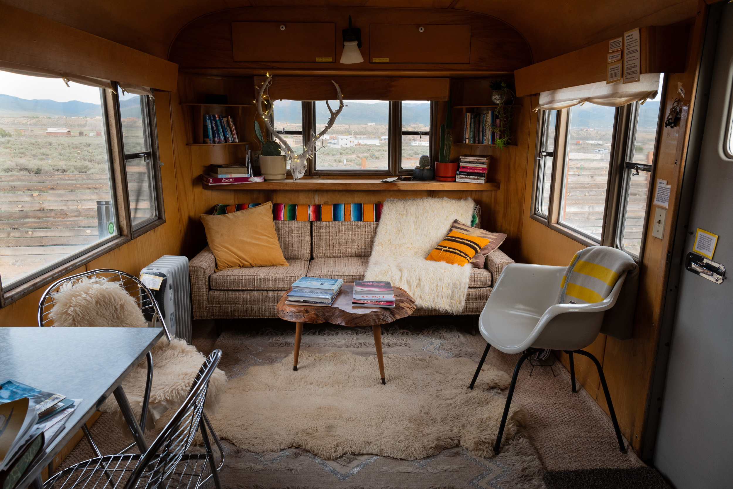 yellow submarine - On a quiet gravel plot outside of Taos, New Mexico, a sweet-hearted school teacher has assembled a collection of nostalgic vintage trailers where mountain views meet mid-century chill.