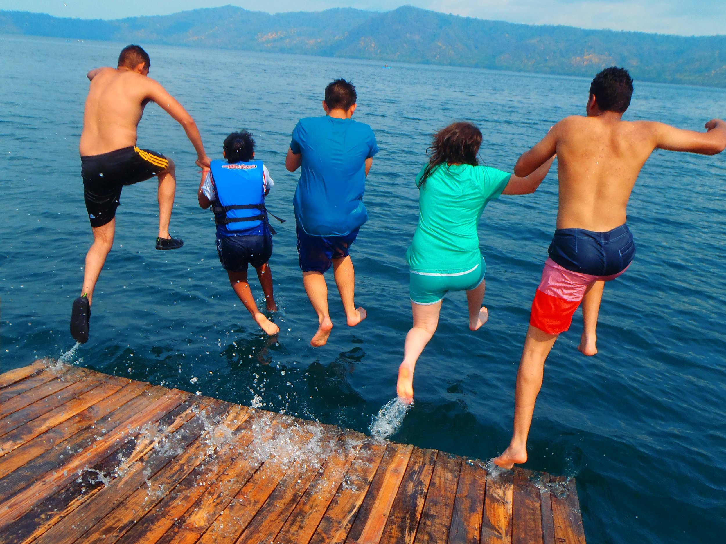 Laguna de Apoyo group jumping from dock.jpg