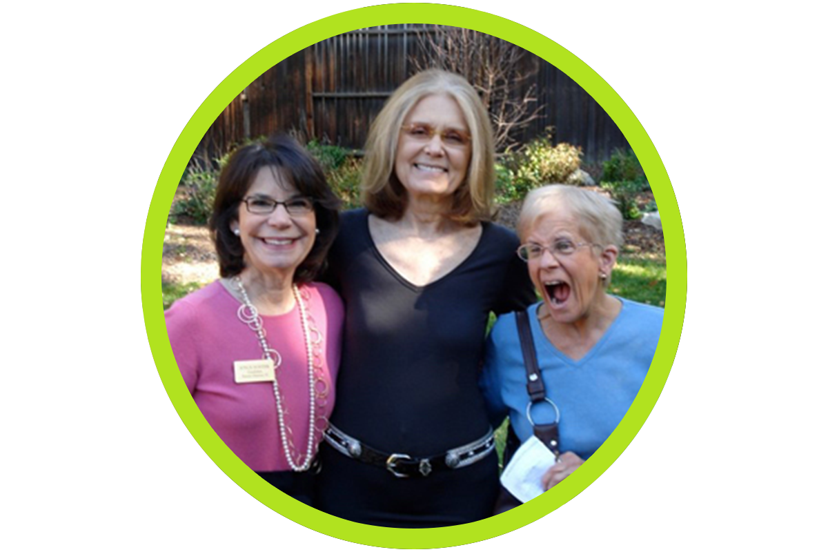 Two women excited with Gloria Steinem