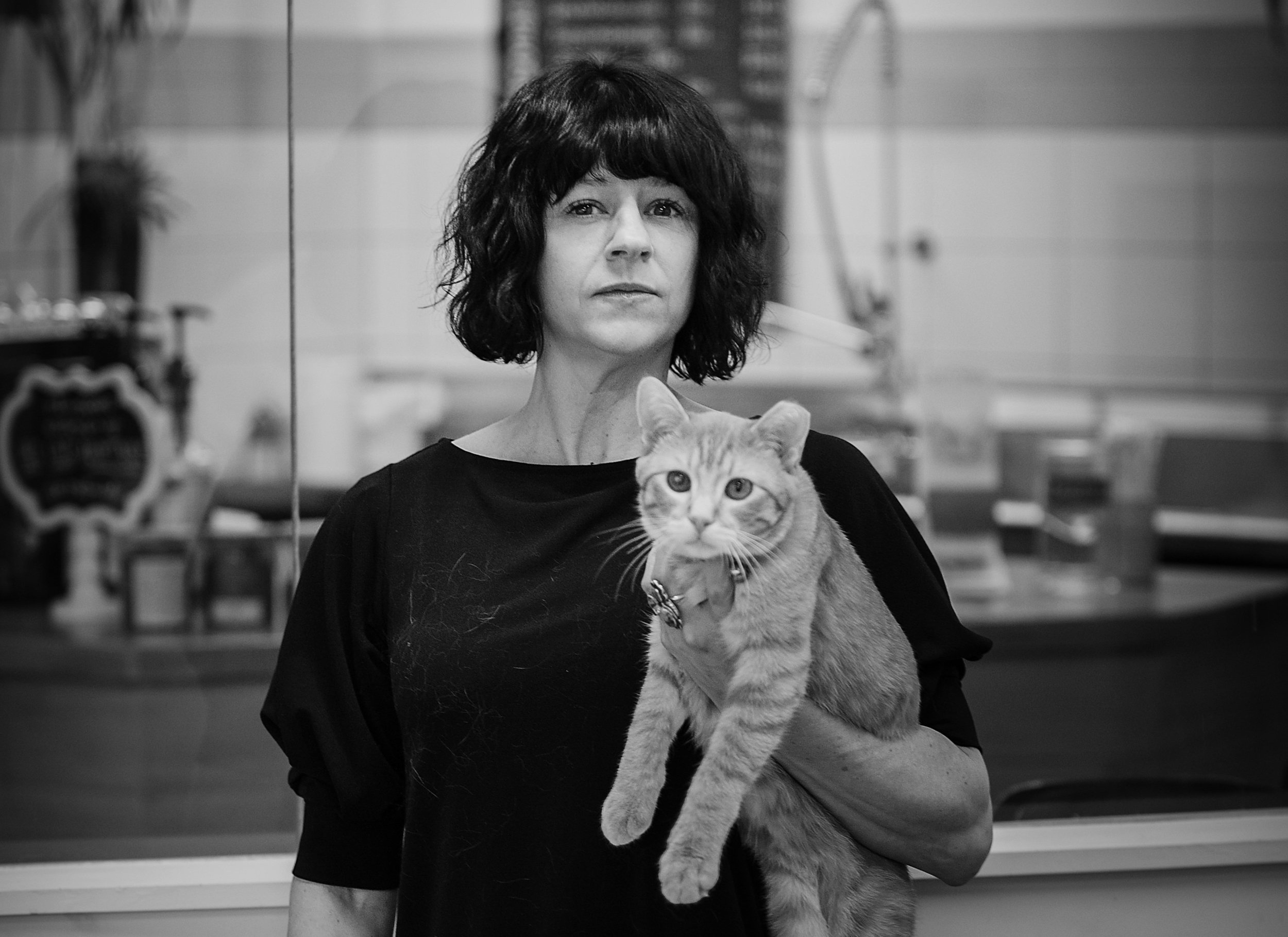 Jessica Hoien, Felius Cat Café Manager with Marquette