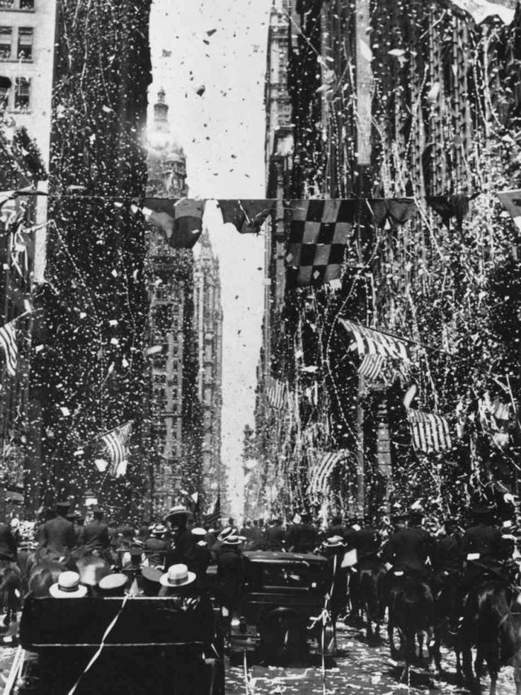New York, June 13th 1927 - On the day of Lindbergh's return from Paris an estimated three million Americans celebrated in the streets of New York. From fifth avenue to lower Broadway the crowds were immense and the confetti raining down on the horse drawn carriages and floats produced one of the finest ticker tape parades this great city has ever witnessed.
