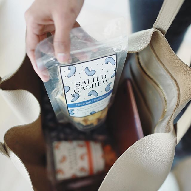 I'm on the go and I'm stocking up on my favorites 💙🧡here's what I'm packing today: - 1 bag of trailblazer - 1 bag of savory duos with cashews  Something sweet and savory to cover all my cravings 🙋🏽‍♀️ #saltedcashew #snacks #trailmix