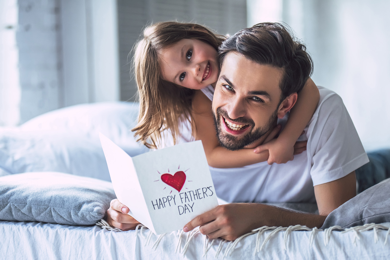 Father and daughter reading father's day card
