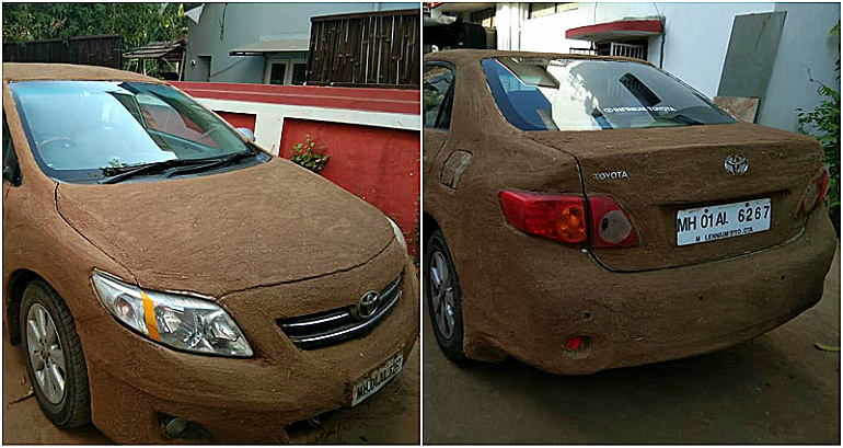 Car in India covered in dung to protect from rising temperatures.