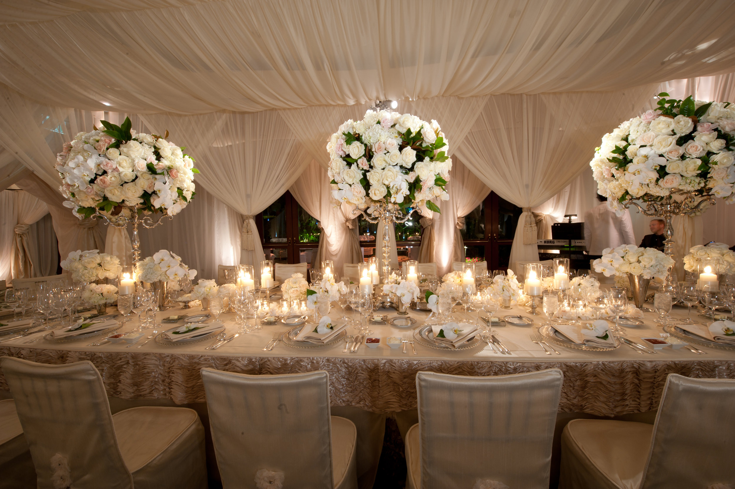 Linen Rentals & Chair Covers - Madison Florist has been providing reception hosts with wide variety of elegant linens in a wide selection of patterns and fabrics including; Table cloths, Overlays, Runners, Chair Covers and Ties.