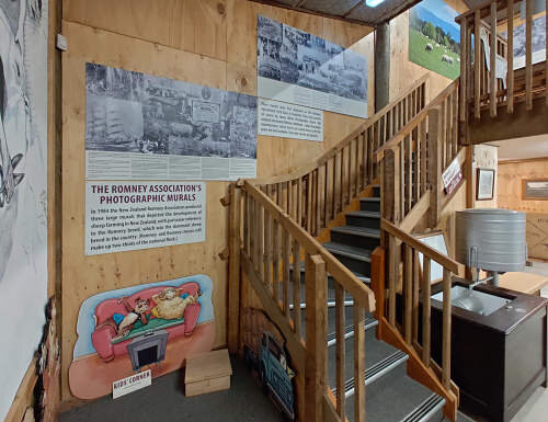 Stairs to the mezzanine gallery, showing some of the vintage photographic sheep industry murals produced by the Romney Association in 1984. More of these murals are on the mezzanine floor.