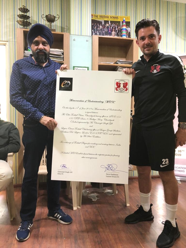 Leyton Orient FC of UK signs an MOU with Elite FC India to Promote Football. Seen in the Picture are Liam Terrence of Leyton Orient FC with Chana Gill of Elite FC