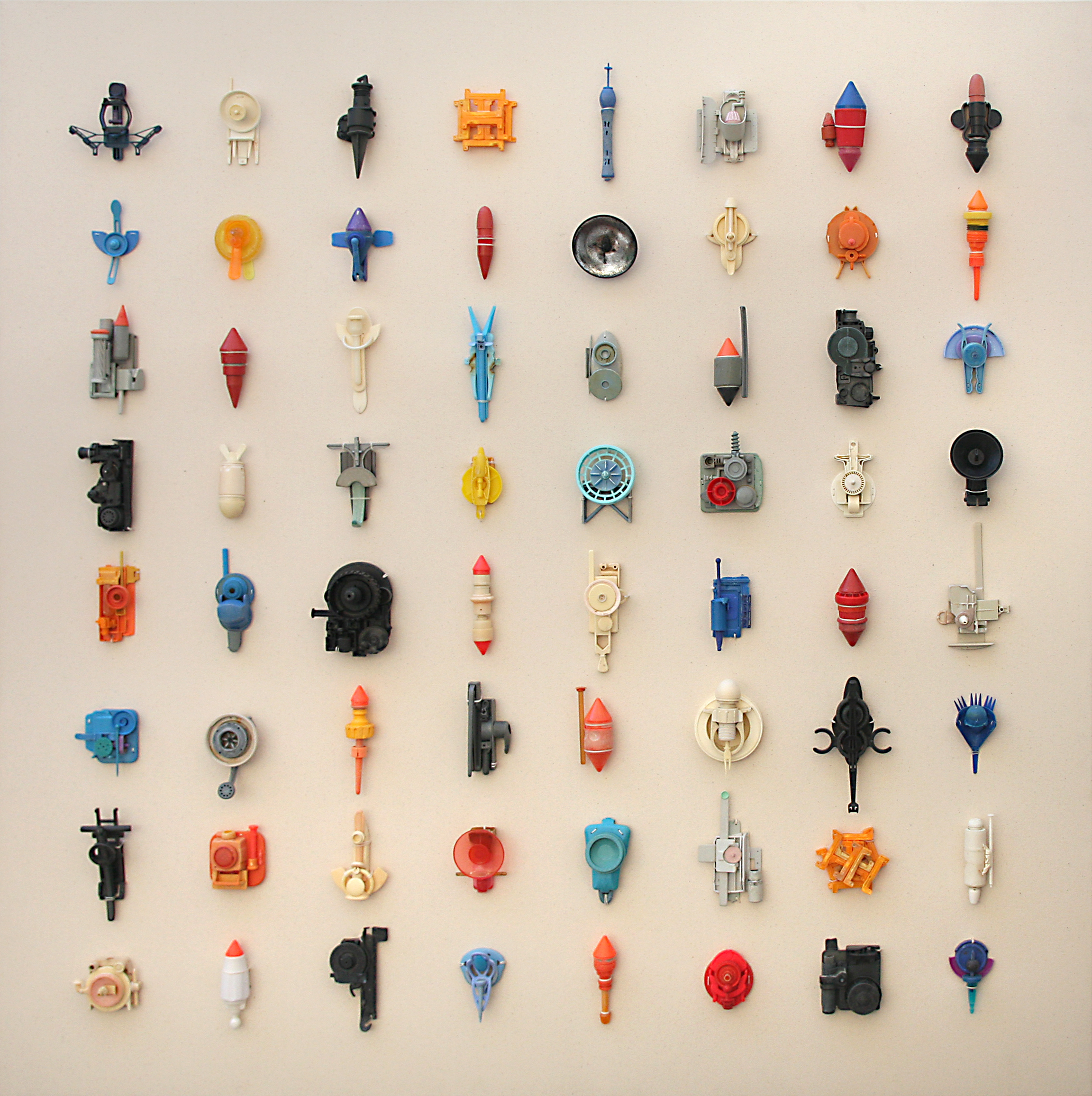 Metaphorms  2018  64 individual sculptures fashioned from unaltered plastic objects found on the UK coast 1994-2018 On canvas; 120 x 120 cm