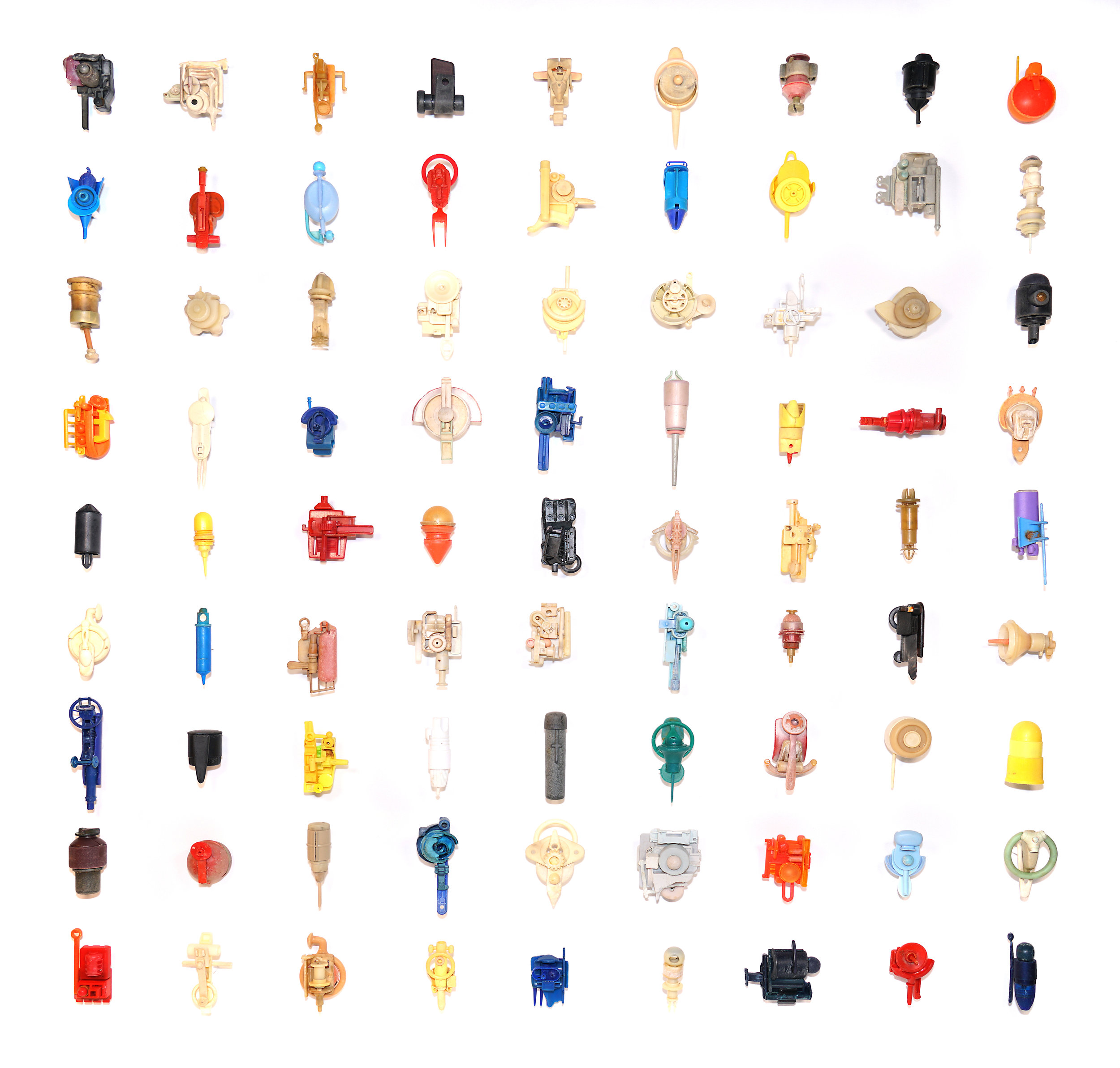 Metaphorms: Novel Mutability  2019  81 individual sculptures fashioned from unaltered plastic objects found on the UK coast 1994-2018 Framed; 102 x 102 cm